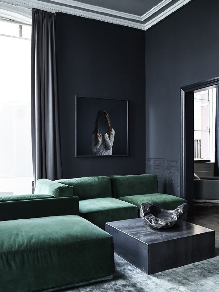 grey interiors with velvet green sofas